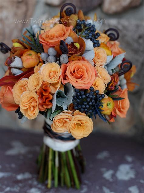 wedding flowers queanbeyan navy orange and grey bridal bouquet with textured flowers