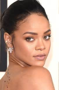 Rihanna wears diamond ear cuffs and climbers by chopard to the 2015