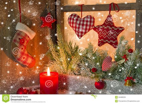 christmas decoration with red candle and hearts stock