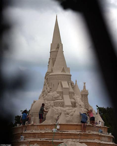 largest beach in the world sand sculptors work to create the world s tallest sand
