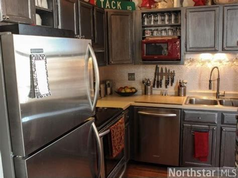 Kitchen cabinets painted with Rust oleum metallic accents
