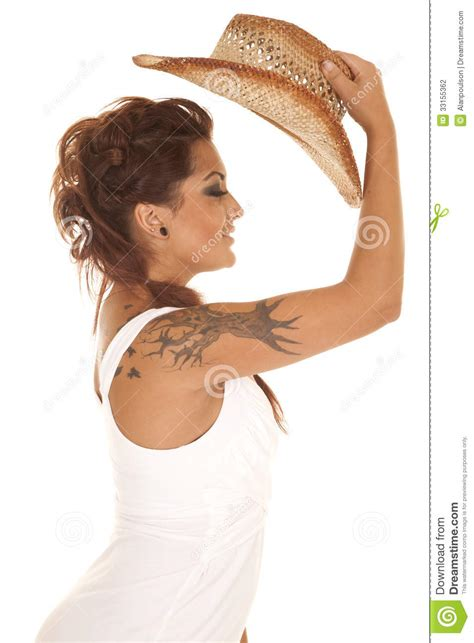 woman tattoos cowgirl put hat  stock photo image