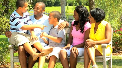 park bench kids clothing african american father son playing soccer stock footage
