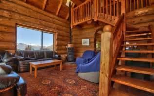 alpine log cabin with beautiful interior and stunning