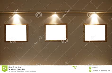 picture frame with light inside empty picture frames on the wall with lighting stock image