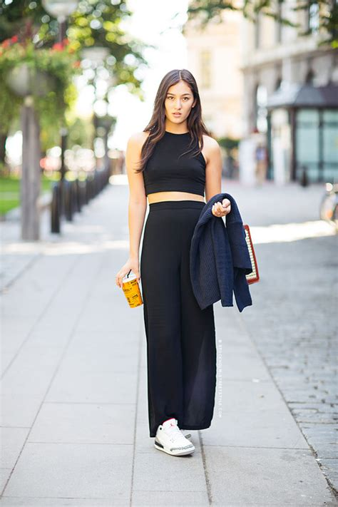 black cropped top and black maxi skirt and white low top