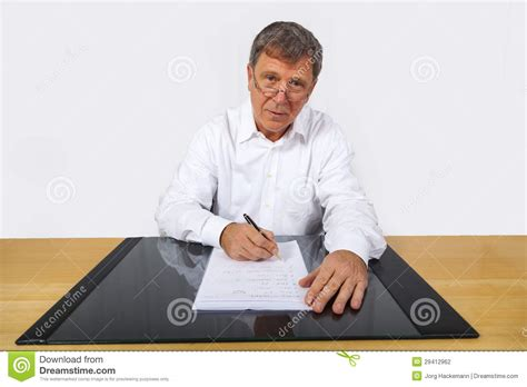 Man Sitting At A Desk Business Man Sitting At His Desk Stock Photography Image