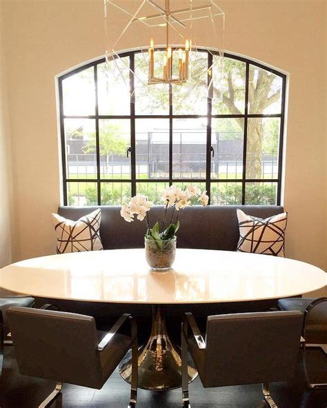 bench in front of window gray armless dining bench in front of arch window