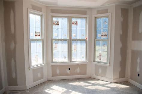 window trim shows the baseboard and window trim