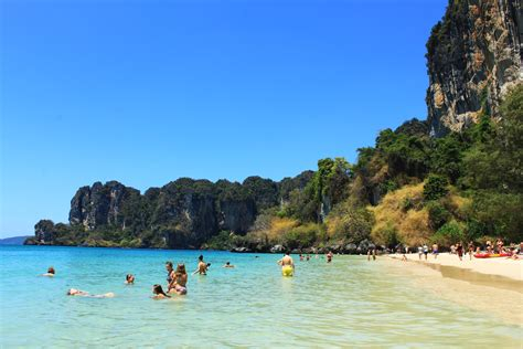 on the beach soaking up the sun on railay beach krabi aonang thailand