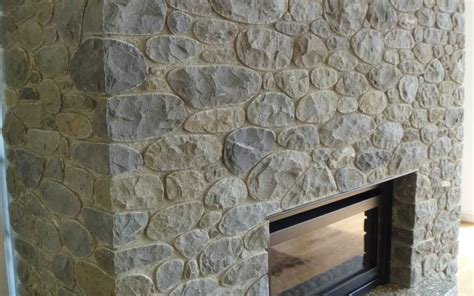 What Type Of Mortar For Fireplace by Split Riverstone Fireplace With Recessed Mortar Joints Southern Stonemasons