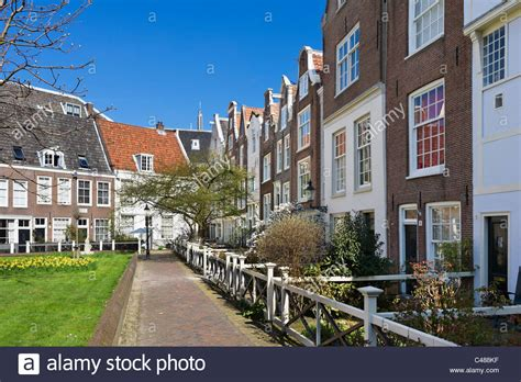 houses to buy in amsterdam historic houses in the begijnhof amsterdam netherlands stock photo royalty free