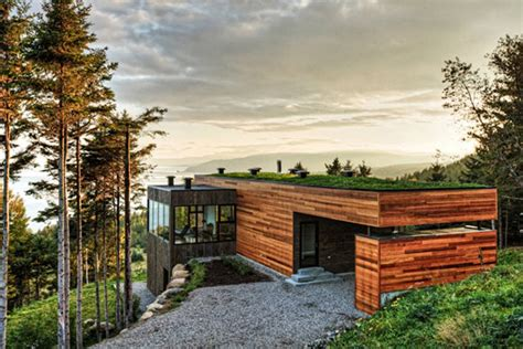 cottage home clad in and surrounded by woods