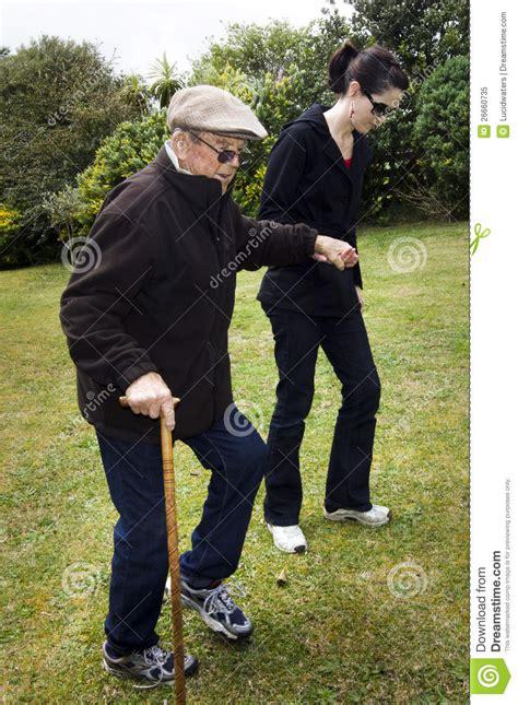 assisting  helping elderly people royalty  stock