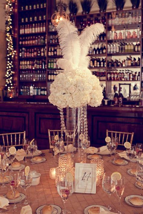 gatsby centerpieces feather wedding centerpieces a gatsby table centerpiece don t you think via shack