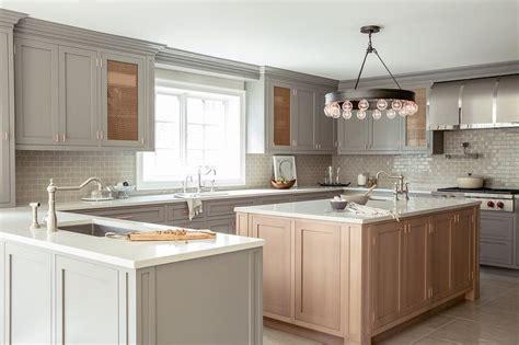 white kitchen cabinets  gray brick tile backsplash