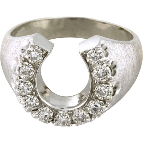 reduced horseshoe ring 14k white gold with 25tcw