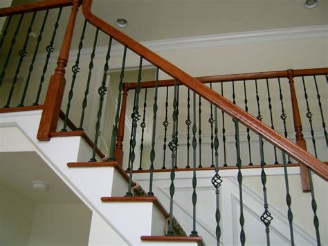 steel ornamental balusters with wood handrail