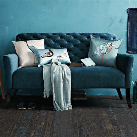 elton settee with a rich teal shade a high back and deep tufting