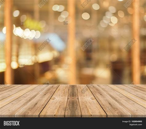 Wooden Board Empty Table blur in coffee shop   can be used for display or montage your products