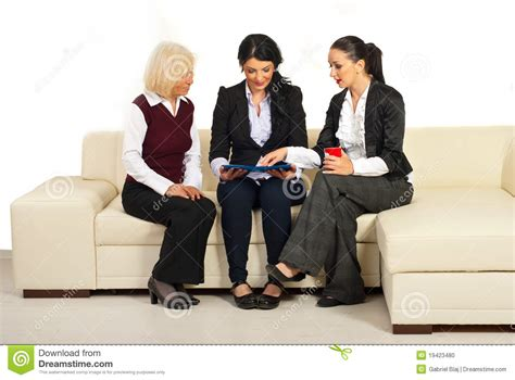 three on a couch three business women discussion on sofa stock photo