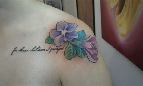 tattoo flower birth month tattoo for my two boys the flowers are there birth month