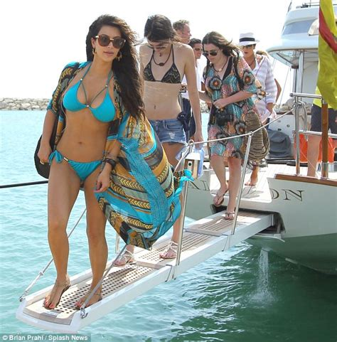 speed boat while pregnant kim kardashian reveals her hour glass shape in studded