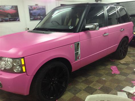 matte black and pink range rover wrapped matte pink colour change black