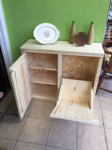25 best ideas about trash can cabinet on