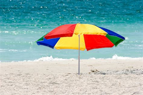 Surf The Web With The Umbrella by Colorful Umbrella Stock Image Image Of Secluded