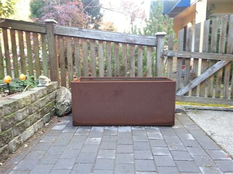 Steel Planters by Corten Steel Planter As A Retaining Wall Or Garden Hedge