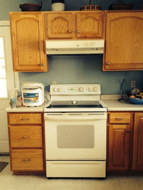 how much space between stove and cabinet help will my over the range microwave be too low