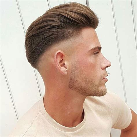 undercut pomp 33 hairstyles for men with straight hair