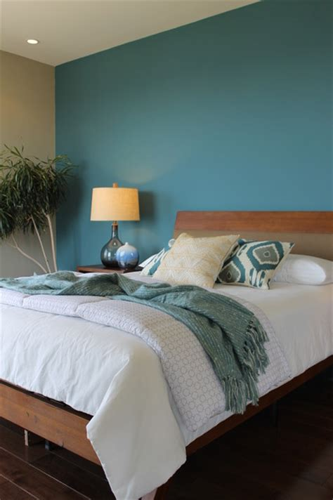 teal bedroom teal blue wall ikat pillows seeded glass ls modern