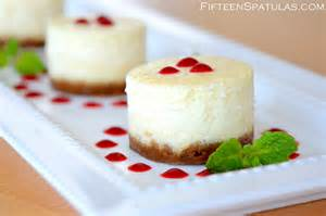 mini cheesecakes with gingersnap crust and raspberry sauce