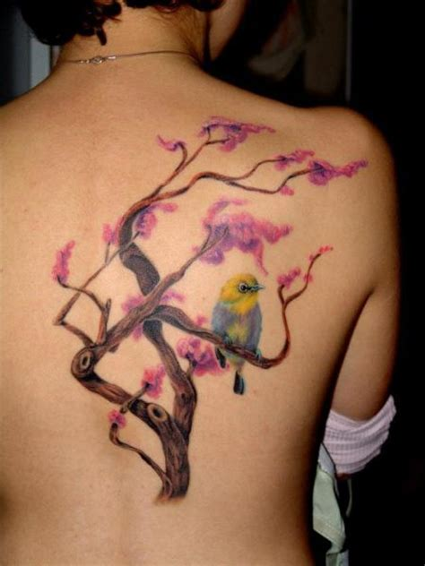 realistic back bird tree tattoo by 2nd skin