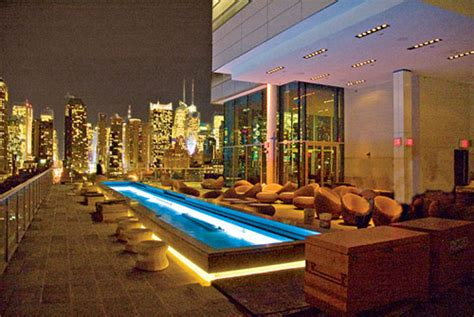 roof top bars new york press lounge ink48 new york s answer to ghostbar