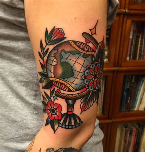 traditional world globe tattoo on nadina s left upper
