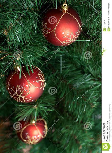 christmas tree decoration big red ball  green  royalty