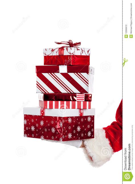 santa claus giving christmas presents stock photography