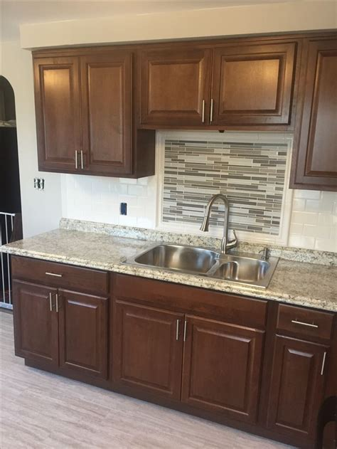 cognac color kitchen cabinets hton bay cognac kitchen cabinets with subway tile