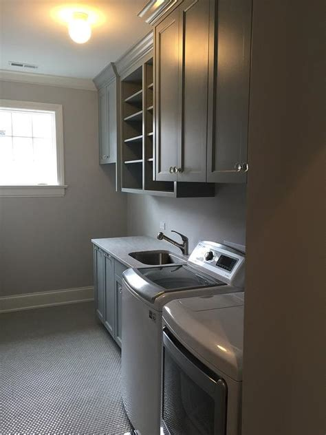 grey laundry room green laundry room with black tile floor contemporary laundry room