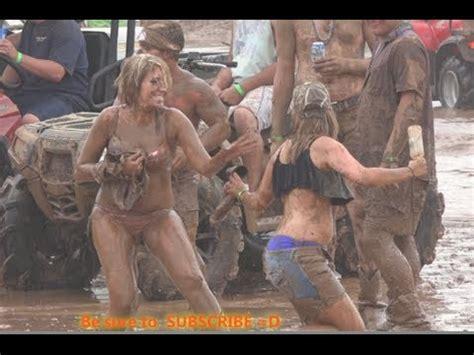Teen couple having sex in mud