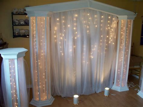 Wedding Backdrop Ideas With Columns by Lighted Columns With Panel Tulle J A