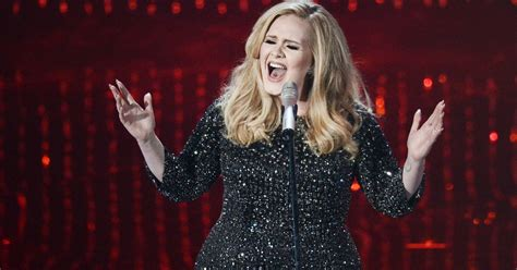 adele s adele s toddler son wins damages from paparazzi photos
