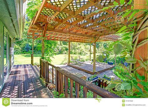 backyard barnyard backyard farm deck with attached open pergola stock photo