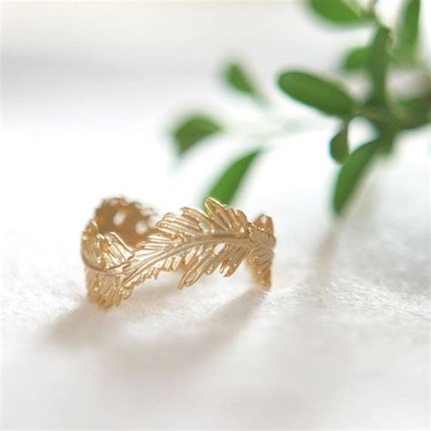 gold feather ring by laonato on etsy