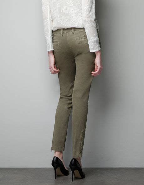 zara trousers with zips in zara combination trousers with zips in khaki lyst