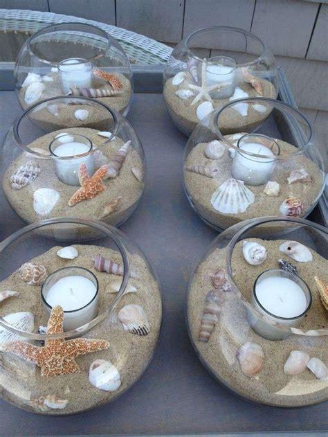 candele con conchiglie centrotavola per il matrimonio con le candele foto
