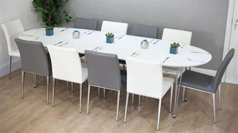 to oval dining table seats 10 modern white satin oval extending dining table 6 10 seater